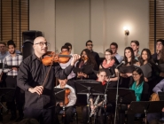 "Music Director Hanna Khoury leads audience in ""Al-Kamanjat"""